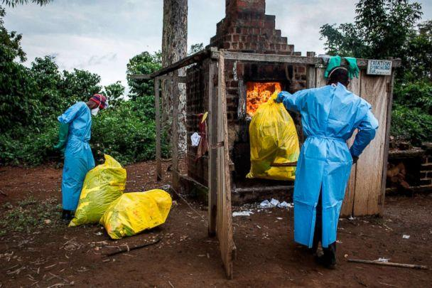 PHOTO: Health workers burn medical waste generated during care of patients with the Ebola virus, Aug. 21, 2018, in Mangina, Democratic Republic of the Congo. (John Wessels/AFP/Getty Images)
