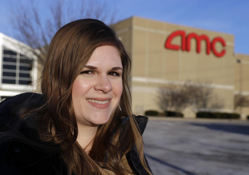 In this Tuesday, Jan. 30, 2018, photo, Cassie Langdon stands outside of AMC Indianapolis 17 theatre in Indianapolis. With MoviePass, Langdon said she's taking more chances on smaller releases instead of sticking with blockbusters and their sequels. (AP Photo/Darron Cummings)