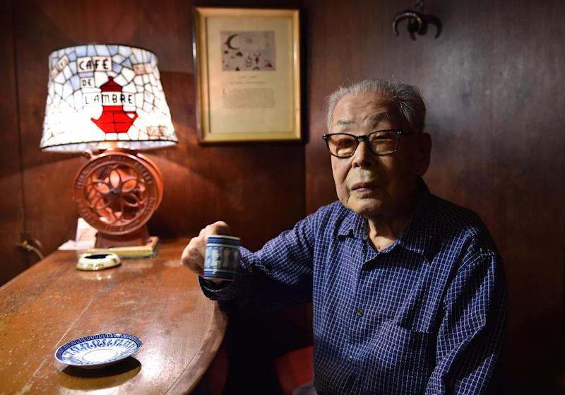100-year-old coffeeshop owner Ichiro Sekiguchi enjoys a cup of coffee at Cafe de L'Ambre in Tokyo's fashion district Ginza on October 8, 2014 (AFP Photo/Yoshikazu Tsuno)