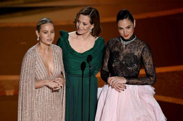 PHOTO: Brie Larson, from left, Sigourney Weaver and Gal Gadot introduce a performance by maestro Eimear Noone at the Oscars, Feb. 9, 2020, at the Dolby Theatre in Los Angeles. (Chris Pizzello/Invision/AP)