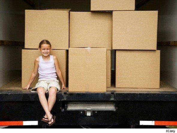 Popular cities to move to: Girl on a moving truck.