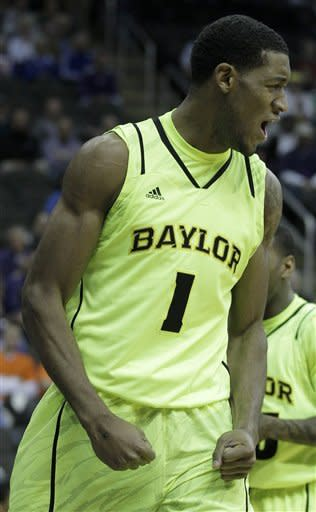 Baylor forward Perry Jones III (1) celebrates after making a basket during the first half of an NCAA college basketball first round game against Kansas State in the Big 12 Conference tournament, Thursday, March 8, 2012, in Kansas City, Mo. (AP Photo/Charlie Riedel)