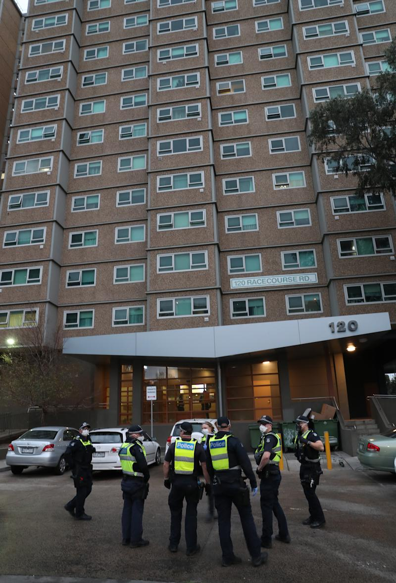 Police enforcing the hard lockdown at one of the towers on Racecourse Road in Flemington. Source: AAP