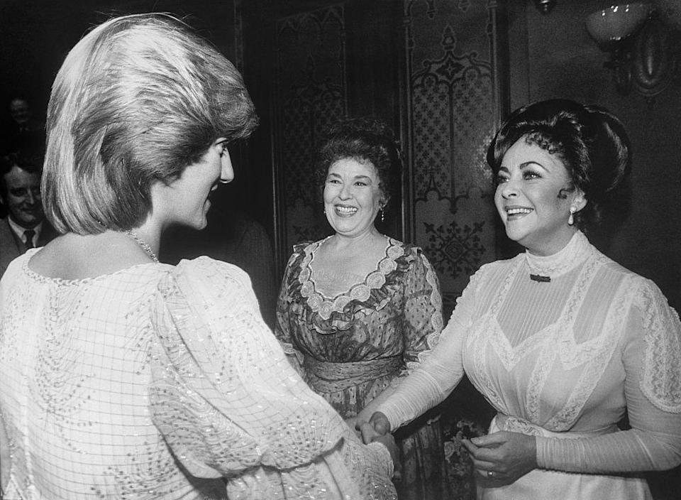 """<p><a href=""""https://www.townandcountrymag.com/leisure/arts-and-culture/a9924719/elizabeth-taylor-family-interview/"""" rel=""""nofollow noopener"""" target=""""_blank"""" data-ylk=""""slk:Elizabeth Taylor"""" class=""""link rapid-noclick-resp"""">Elizabeth Taylor</a> ditched her typical flashy evening gowns for an understated white muslin Victorian-era dress. But this outfit wasn't necessarily the actress's choice: She was still in costume from her charity performance of <em>The Little Foxes. </em></p>"""