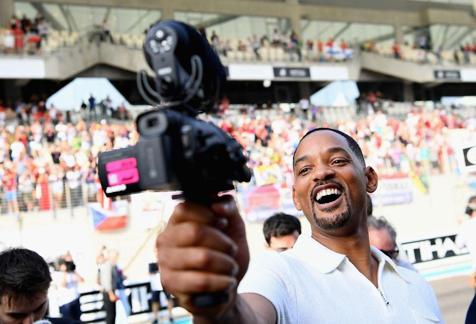 <p>Will Smith films himself on the drivers parade before the Abu Dhabi Formula One Grand Prix at Yas Marina Circuit on November 25, 2018 in Abu Dhabi, United Arab Emirates.</p>