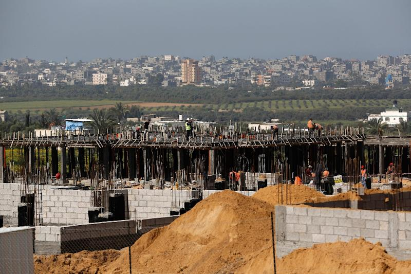 Palestinian labourers work on a Turkish funded project to build 320 housing units east of Gaza City for families who lost their homes during the 50-day war between Israel and Hamas-led militants in 2014 (AFP Photo/Mohammed Abed)