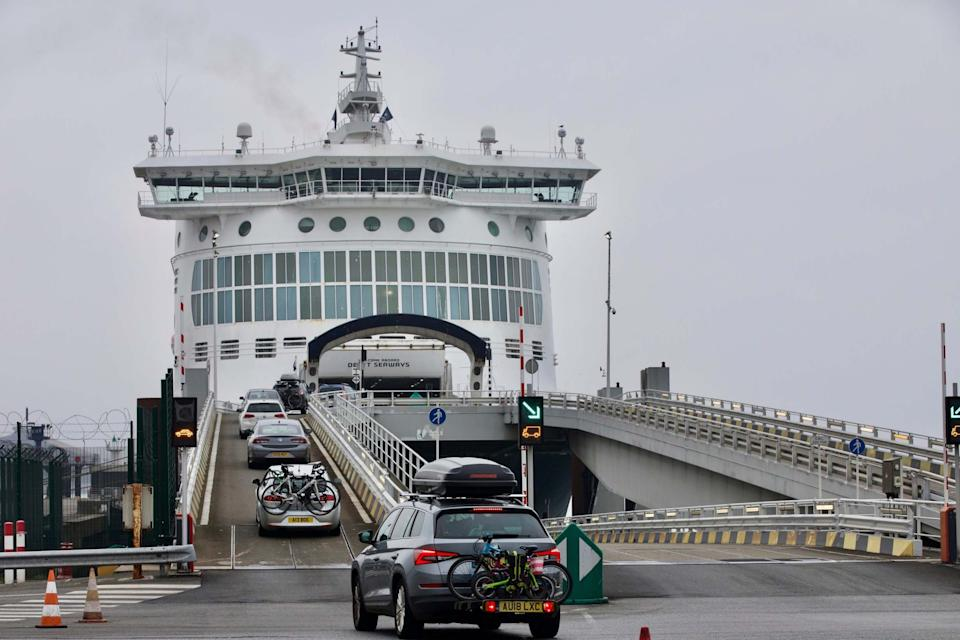 Cars are loaded onto a cross-channel ferry at the Port of Dunkerque, France hours before new restrictions come into force (AP)