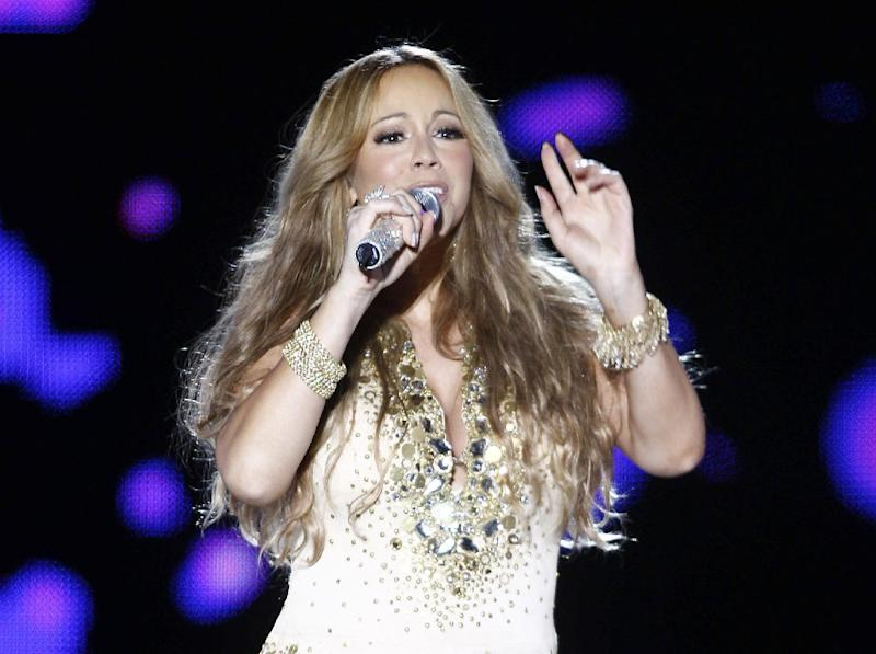 FILE - This May 26, 2012 file photo shows U.S. Singer Mariah Carey performing on stage during a concert at the Mawazine Festival in Rabat, Morocco. Carey and No Doubt are set to perform ahead of the first game of the NFL season Sept. 5 in New York. They will take the stage live for NFL Kickoff 2012 from Rockefeller Plaza before the New York Giants take on the Dallas Cowboys at MetLife Stadium. The hour-long pregame show will air at 7:30 p.m. ET on NBC.  (AP Photo/Abdeljalil Bounhar, file)