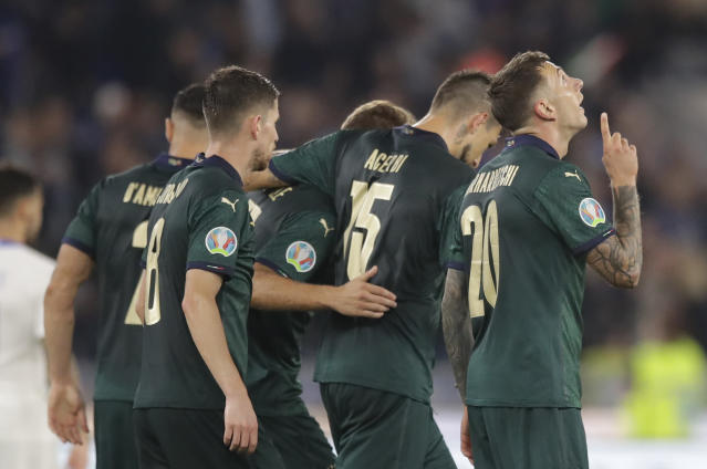 Italy's Frederico Bernardeschi, right celebrates with teammates after scoring his side second gaol during the Euro 2020 group J qualifying soccer match between Italy and Greece in Rome, Italy, Saturday, Oct. 12, 2019. (AP Photo/Alessandra Tarantino)