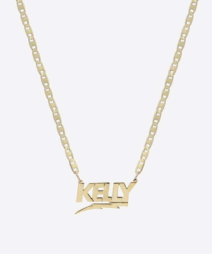 """<p>""""I've been obsessed with Shami's jewelry for a few years now, and I love the lightning-bolt detail on this <span>Shami Bolt Nameplate Necklace</span> ($160).""""</p>"""