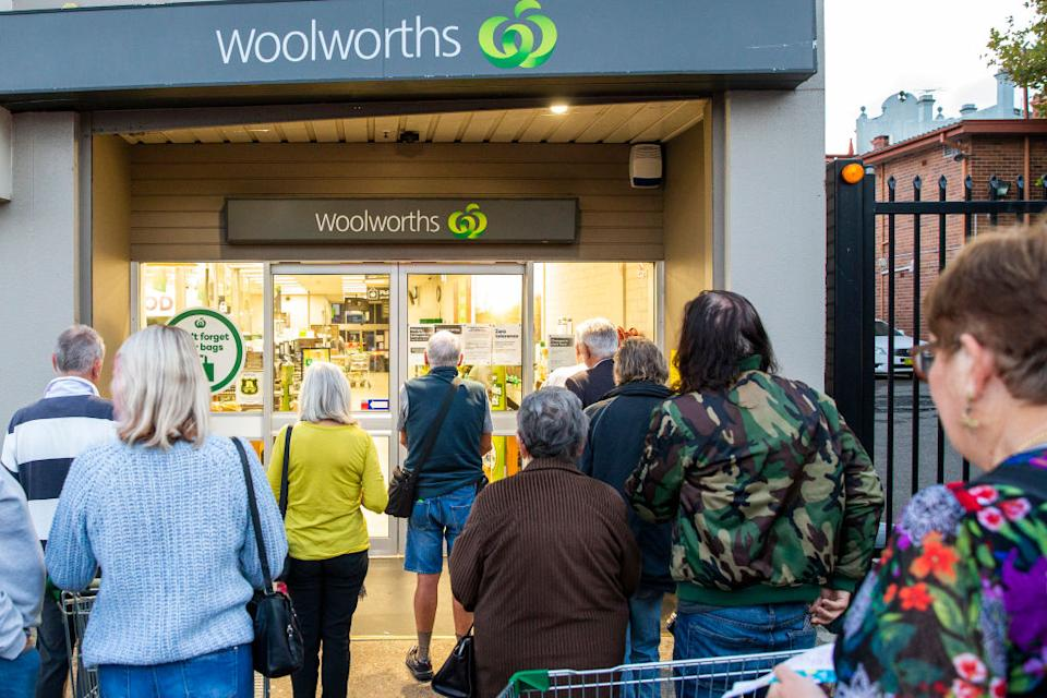 Elderly people are seen waiting for the opening of Woolworths supermarket in Balmain.