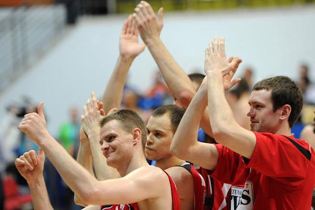 Lietuvos Rytas's players celebrate their victory at the end of the Eurocup's Final Four third place basketball match between Lietuvos Rytas and BC Spartak Saint-Petersburg in Khimki, a suburb of Moscow, on April 15, 2012. AFP PHOTO / KIRILL KUDRYAVTSEV