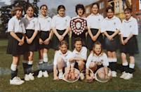 <p>While Kate's favorite sport was field hockey, she was also a star tennis player. Here, she posed with her tennis teammates at St Andrew's School. Young Kate (top, third from left) looked adorable in her uniform. </p>