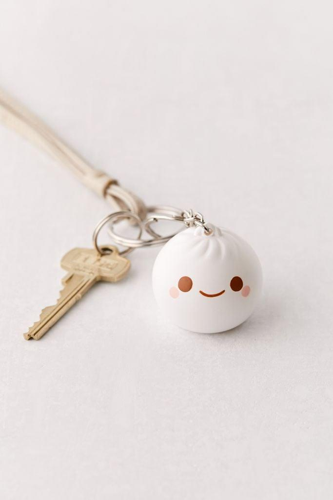 <p>We might have to snag one of these <span>Smoko Light-Up Dumpling Keychains</span> ($9) for ourselves, too - twinsies! *cue teen groans*</p>