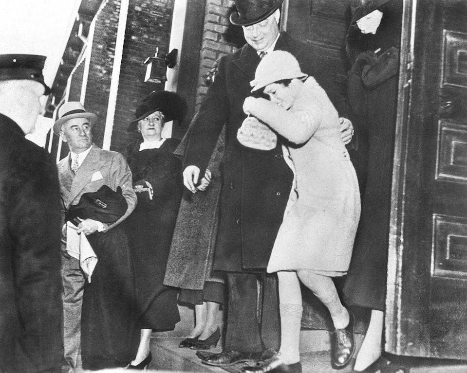 <p>Vanderbilt leaves St. Francis Catholic Church in Garden City, New York, with her aunt (right) after attending a service. Gloria, by a Supreme Court ruling, spent weekdays with her aunt and weekends with her mother.</p>