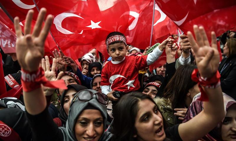 Supporters of Turkey's president, Recep Tayyip Erdogan, wave and cheer at a rally in Istanbul.
