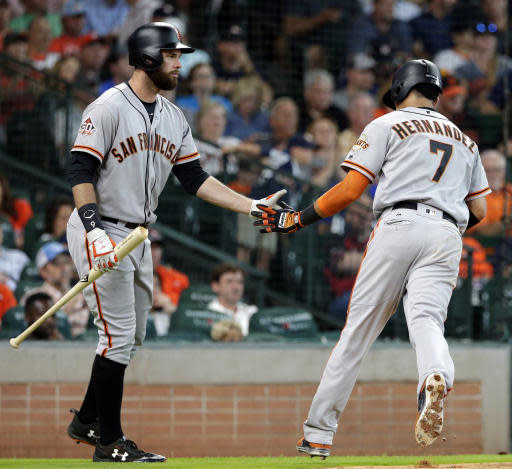 San Francisco Giants Brandon Belt, left, congratulates Gorkys Hernandez (7) after scoring the first run of the game during the fourth inning of a baseball game Wednesday, May 23, 2018, in Houston. (AP Photo/Michael Wyke)