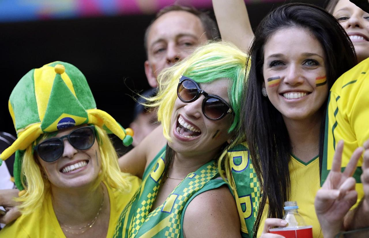 Supporters react before the start of the second half of the group H World Cup soccer match between Belgium and Algeria at the Mineirao Stadium in Belo Horizonte, Brazil, Tuesday, June 17, 2014. (AP Photo/Hassan Ammar)