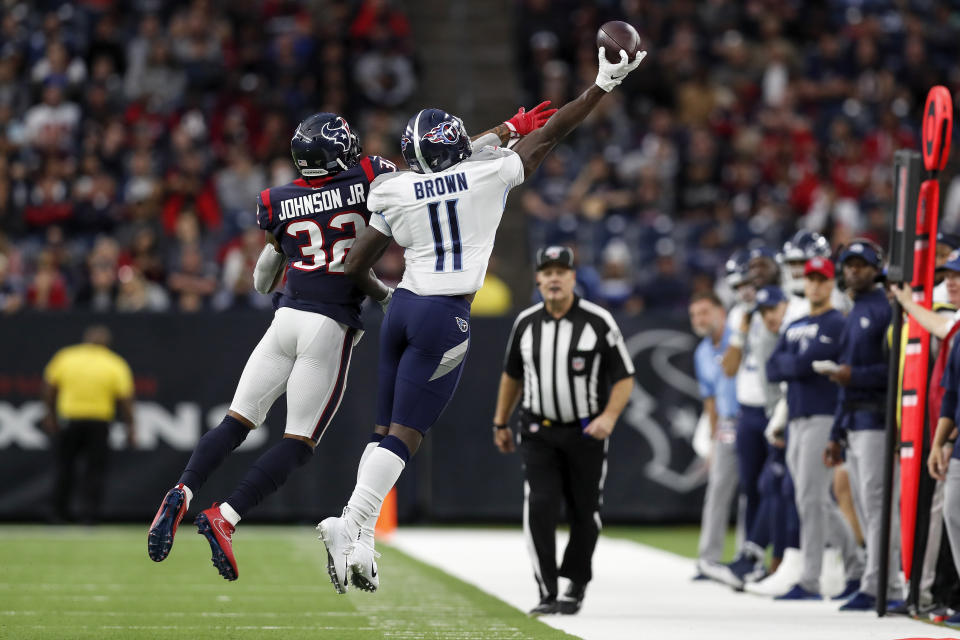 HOUSTON, TX - DECEMBER 29:  Lonnie Johnson #32 of the Houston Texans defends a pass intended for A.J. Brown #11 of the Tennessee Titans in the second quarter at NRG Stadium on December 29, 2019 in Houston, Texas.  (Photo by Tim Warner/Getty Images)