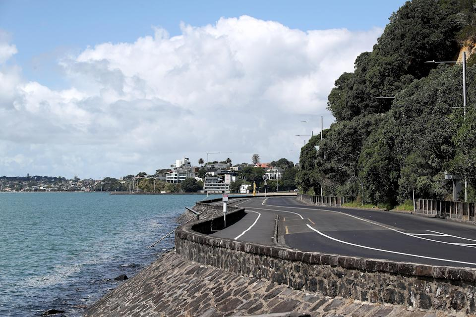 <p>Tamaki Drive is shown empty of cars and people due to a tsunami warning following a series of earthquakes on 5 March, 2021, in Auckland, New Zealand</p> (Getty Images)