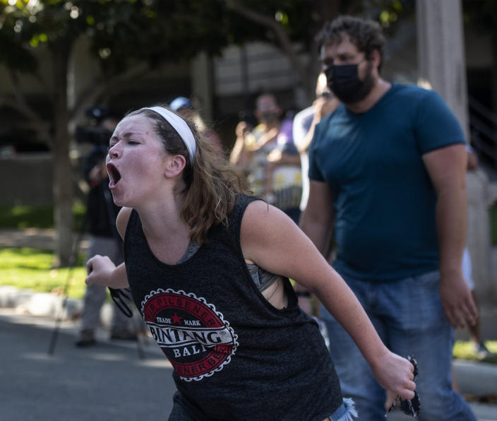 Counterprotesters yell from across the street at supporters of Republican Reps. Marjorie Taylor Greene and Matt Gaetz at a rally outside City Hall on Saturday, July, 17, 2021, in Riverside, Calif. (Cindy Yamanaka/The Orange County Register via AP)