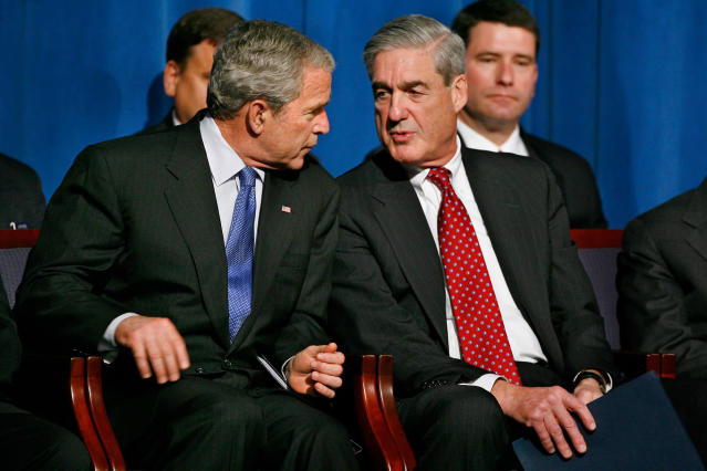 <p>President Bush, left, speaks with FBI Director Robert Mueller during a graduation ceremony for new FBI agents, Thursday, Oct. 30, 2008, at the FBI Academy in Quantico, Va. (Photo: Jacquelyn Martin/AP) </p>