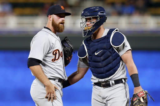 Detroit Tigers pitcher Buck Farmer, left, and catcher James McCann chat on the mound during the seventh inning of the team's baseball game against the Minnesota Twins on Tuesday, May 22, 2018, in Minneapolis. The Twins won 6-0. (AP Photo/Jim Mone)