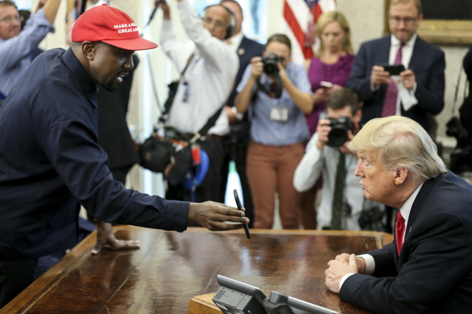 Rapper Kanye West with President Trump during a meeting in the Oval office of the White House on Oct. 11, 2018. (Photo: Oliver Contreras/Getty Images)