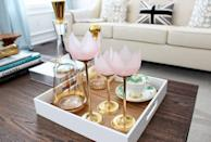 "<p>Real flowers are beautiful, of course, and one of the easiest ways to add a little romance to your space. But these <span class=""redactor-unlink"">tulip-shaped candle holders</span> may be even more lovely. The vintage-inspired pink glass pairs perfectly with the gilded base to create a timeless look. </p><p><em>Via <a href=""http://www.amdolcevita.com/2014/02/valentines-coffee-table-styling.html"" rel=""nofollow noopener"" target=""_blank"" data-ylk=""slk:AM Dolce Vita"" class=""link rapid-noclick-resp"">AM Dolce Vita</a> </em><br></p><p><a class=""link rapid-noclick-resp"" href=""https://go.redirectingat.com?id=74968X1596630&url=https%3A%2F%2Fwww.etsy.com%2Flisting%2F904548792%2Fbrass-glass-tulip-candle-holder-set3%3Fga_order%3Dmost_relevant%26ga_search_type%3Dall%26ga_view_type%3Dgallery%26ga_search_query%3Dtulip%2Bcandle%2Bholders%26ref%3Dsc_gallery-1-1%26plkey%3D13267058d483c4f67b2ccd1c6667ea8e92bea1a4%253A904548792%26frs%3D1&sref=https%3A%2F%2Fwww.elledecor.com%2Flife-culture%2Ffun-at-home%2Fg2387%2Fvalentines-day-decor%2F"" rel=""nofollow noopener"" target=""_blank"" data-ylk=""slk:GET THE LOOK"">GET THE LOOK</a><em><br>Brass Glass Tulip Candle Holder Set, Etsy, $43.65</em></p>"