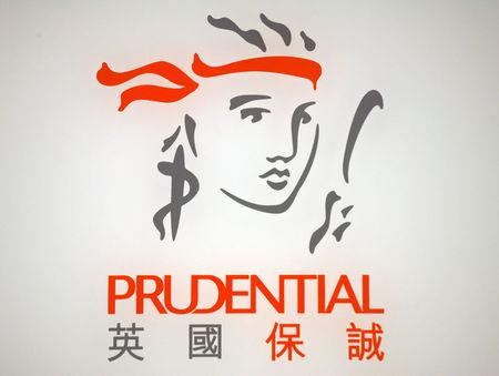 FILE PHOTO: The company logo of Prudential is seen at its headquarters in Hong Kong March 9, 2010.   REUTERS/Bobby Yip /File Photo
