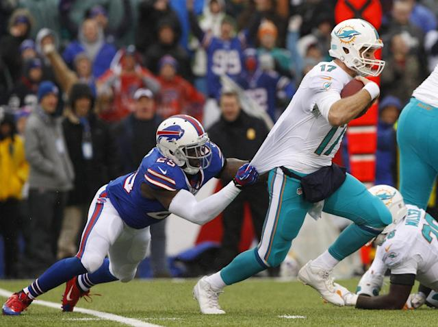 Miami Dolphins quarterback Ryan Tannehill (17) is sacked by Buffalo Bills strong safety Da'Norris Searcy (25) during the first half of an NFL football game on Sunday, Dec. 22, 2013, in Orchard Park, N.Y. (AP Photo/Bill Wippert)