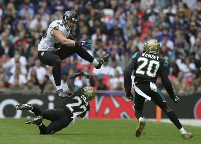 <p>Baltimore Ravens tight end Nick Boyle (86) leaps above Jacksonville Jaguars cornerback Aaron Colvin (22) during the second half of an NFL football game at Wembley Stadium in London, Sunday Sept. 24, 2017. (AP Photo/Tim Ireland) </p>