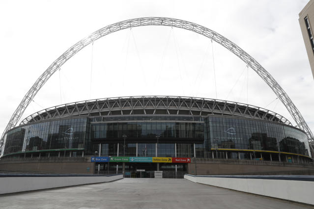 FILE- In this file photo dated Tuesday, March 17, 2020, a general view of Wembley Stadium in London. Wembley Stadium was due to stage European Championship games including the semifinals and finals next month but the tournament is postponed by a year, and according to an announcement Monday June 29, 2020, the English Football Association is set to make 82 people redundant as it faces a funding shortfall due to the coronavirus pandemic (AP Photo/Alastair Grant, FILE)