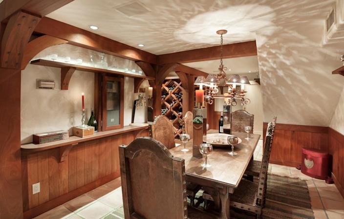 """<p>The home has a wine tasting room and 5,000-bottle wine cellar. (All photos via <a href=""""http://bit.ly/1OjQdjg"""" rel=""""nofollow noopener"""" target=""""_blank"""" data-ylk=""""slk:Concierge Auctions listing"""" class=""""link rapid-noclick-resp"""">Concierge Auctions listing</a>)<br></p>"""