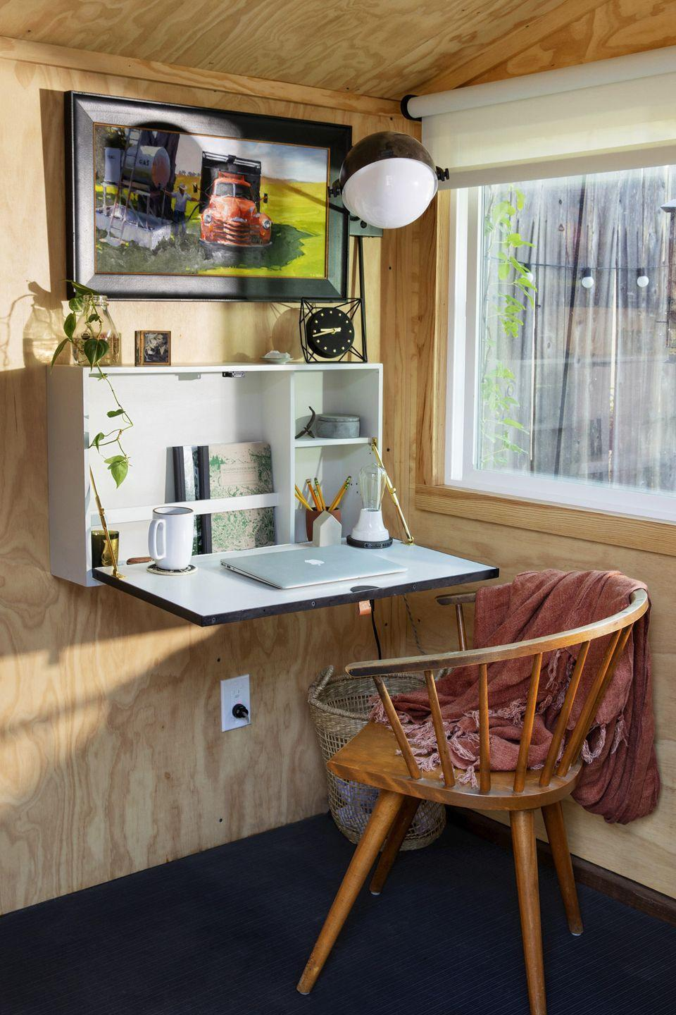 """<p>If you can't designate an entire room for a home office, add a flip-down work area to just about any corner. Even when your work day is over, you can keep your notebooks, laptop and other supplies tucked inside — out of sight, out of mind.</p><p><strong>RELATED:</strong> <a href=""""https://www.goodhousekeeping.com/home/organizing/g25576393/desk-organization-ideas/"""" rel=""""nofollow noopener"""" target=""""_blank"""" data-ylk=""""slk:Easy Ways to Organize Your Desk"""" class=""""link rapid-noclick-resp"""">Easy Ways to Organize Your Desk</a></p>"""