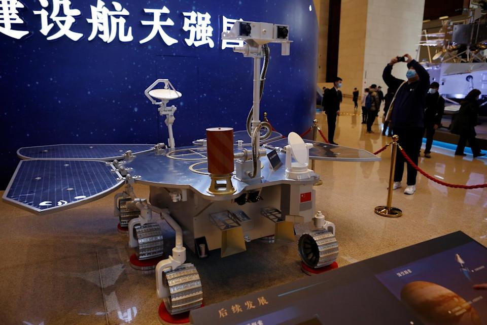 A replica of the Tianwen-1 Mars rover is displayed during an exhibition inside the National Museum in Beijing, China March 3, 2021. REUTERS/Tingshu Wang - RC2N3M9NS23I