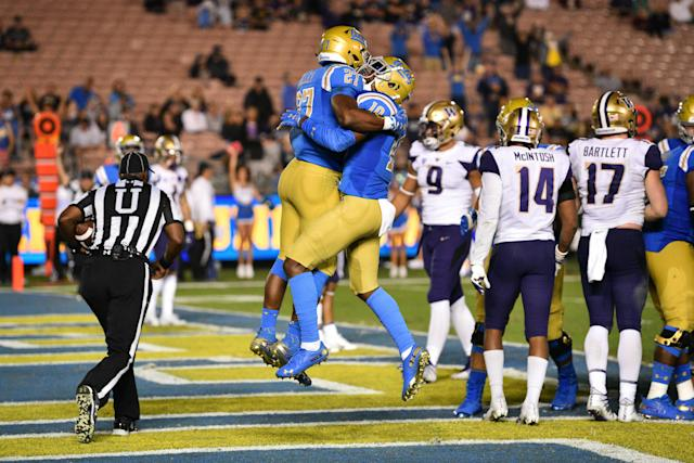UCLA's Joshua Kelley (27) and Demetric Felton (10) hope to do more celebrating this week against USC. (Photo by Brian Rothmuller/Icon Sportswire via Getty Images)