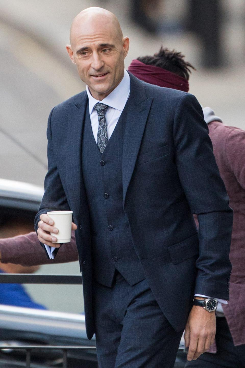 <p>Mark Strong looks sharp while filming an episode of the TV series <i>Temple</i> in London on Monday.</p>