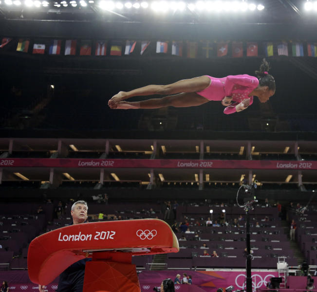 U.S. gymnast Gabrielle Douglas performs on the vault during training at the 2012 Summer Olympics, Thursday, July 26, 2012, in London. (AP Photo/Julie Jacobson)
