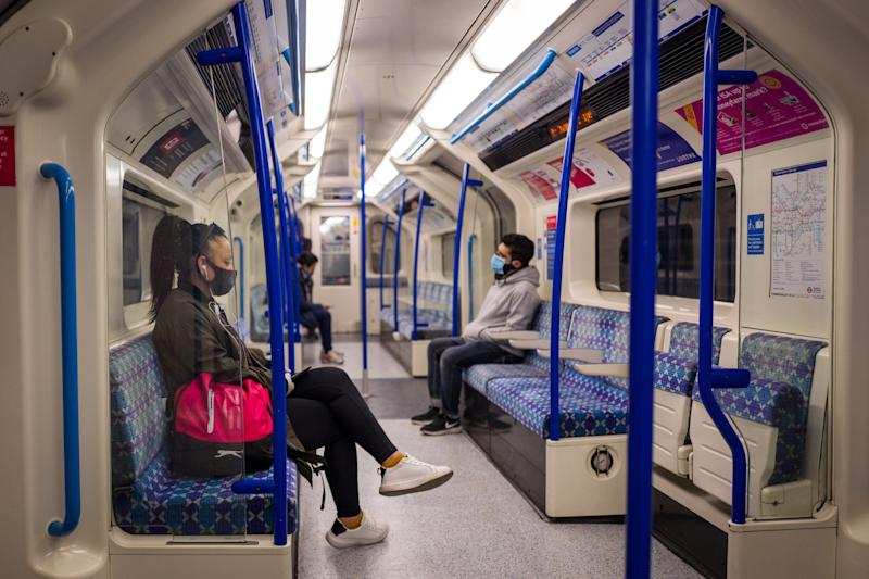 Passengers sit in a quiet London Underground tube train in London on May 14, 2020 after a partial loosening of the coronavirus lockdown guidelines. Photo by TOLGA AKMEN/Tolga Akmen/AFP via Getty Images