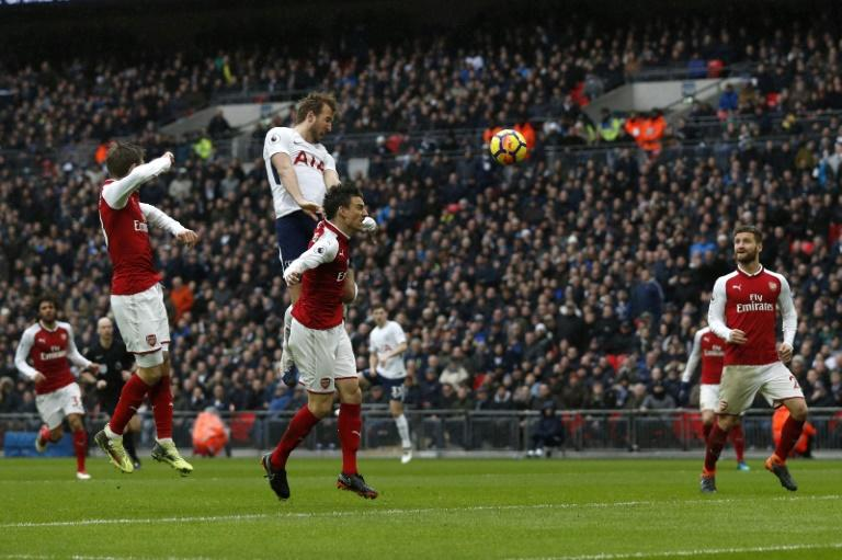 Tottenham Hotspur's Harry Kane (2L) scores the opening goal against Arsenal