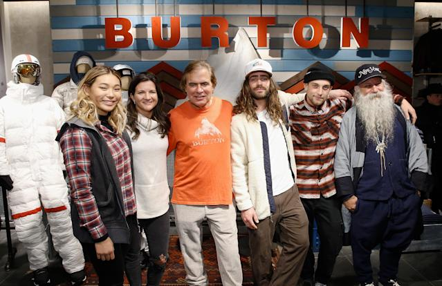 Burton pro snowboard riders, Chloe Kim, Kelly Clark, Danny Davis and Ben Ferguson are joined by Chairman Jake Carpenter (C) and head designer, Greg Dacyshyn (far Right) ahead of the 2018 Olympics. (John Lamparski/Getty Images)