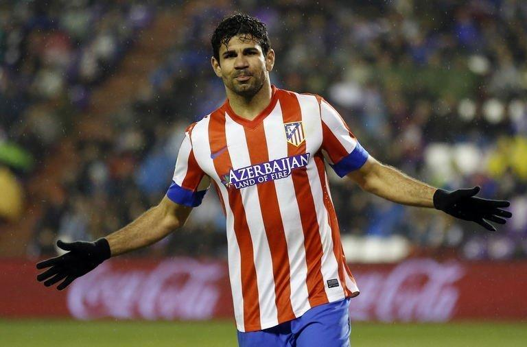 Atletico Madrid's Brazilian forward Diego Costa celebrates after scoring during the Spanish league football match Real Valladolid CF vs Atletico de Madrid at Jose Zorilla stadium in Valladolid on February 17, 2012. Atletico Madrid moved back to within 12 points of Barcelona at the top of La Liga with a comfortable 3-0 win