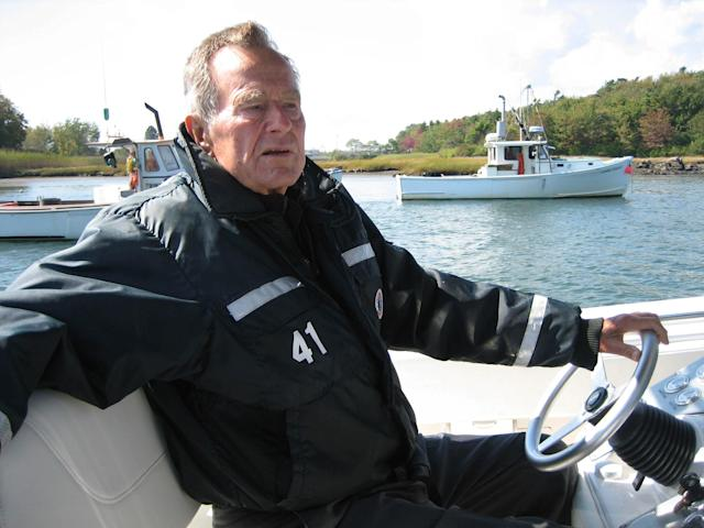 "This undated image released by HBO shows former President George H.W. Bush on his boat in Kennebunkport, Maine during the filming of the documentary ""41,"" premiering Thursday, June 14, at 9:00 p.m. EST on HBO. (AP Photo/HBO, Jeffrey Roth)"