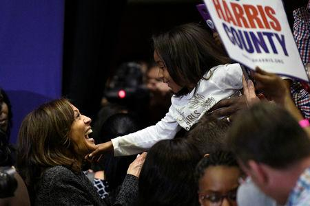 U.S. 2020 Democratic presidential candidate Kamala Harris greets a young supporter at the end of a rally at Texas Southern University in Houston, Texas, U.S., March 23, 2019.  REUTERS/Loren Elliott