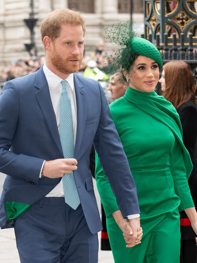 The lining of Harry's suit is green, matching Meghan's ensemble. (Photo: Mark Cuthbert via Getty Images)