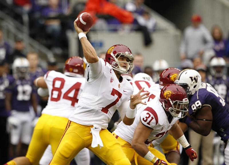 FILE - In this Oct. 13, 2012, file photo, Southern California's Matt Barkley throws a pass against Washington during an NCAA college football game in Seattle. Barkley was chosen with the 98th overall pick in the fourth round of the NFL draft by the Philadelphia Eagles on Saturday, April 27, 2013. (AP Photo/Elaine Thompson, File)