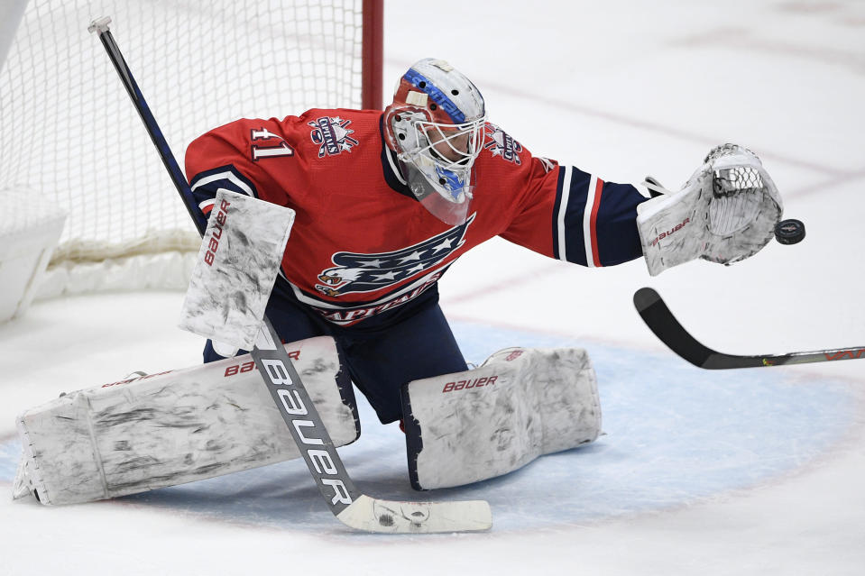 Washington Capitals goaltender Vitek Vanecek (41) reaches to catch the puck during the second period of an NHL hockey game against the Pittsburgh Penguins, Tuesday, Feb. 23, 2021, in Washington. (AP Photo/Nick Wass)