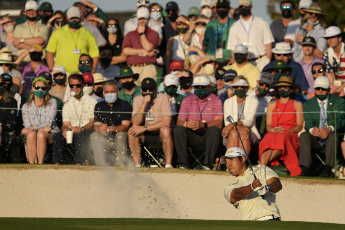 Hideki Matsuyama, of Japan, hits out of a bunker at the 18th green during the final round of the Masters golf tournament on Sunday, April 11, 2021, in Augusta, Ga. (AP Photo/Charlie Riedel)