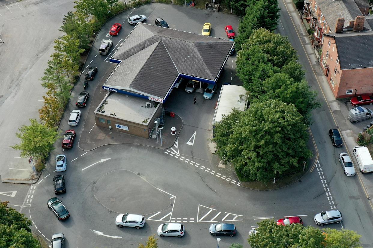 NORTHWICH, UNITED KINGDOM - SEPTEMBER 24: An aerial view of people queuing for petrol and diesel at a Tesco's Supermarket on September 24, 2021 in Northwich, United Kingdom. BP and Esso have announced that its ability to transport fuel from refineries to its branded petrol station forecourts is being impacted by the ongoing shortage of HGV drivers and as a result, it will be rationing deliveries to ensure continuity of supply. (Photo by Christopher Furlong/Getty Images)